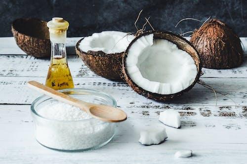 White Powder in Clear Glass Jar Beside Brown Wooden Spoon