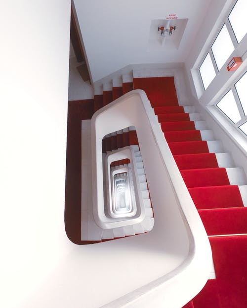 White and Red Concrete Staircase of a Building