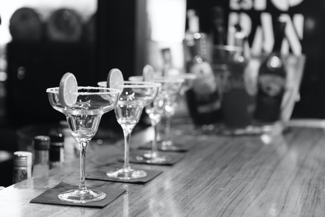 Grayscale Photography of Margarita Glass on Table