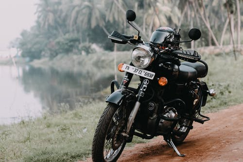 Black and Gray Motorcycle on Green Grass Field