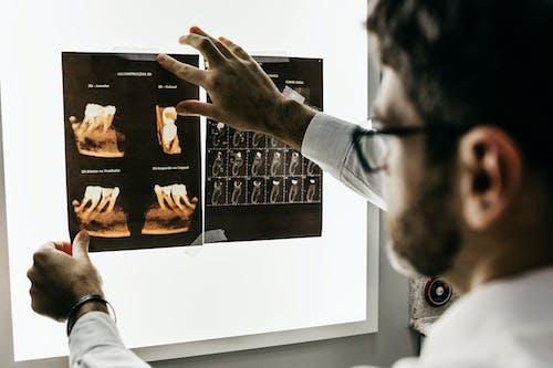 Man Looking at Teeth X-rays