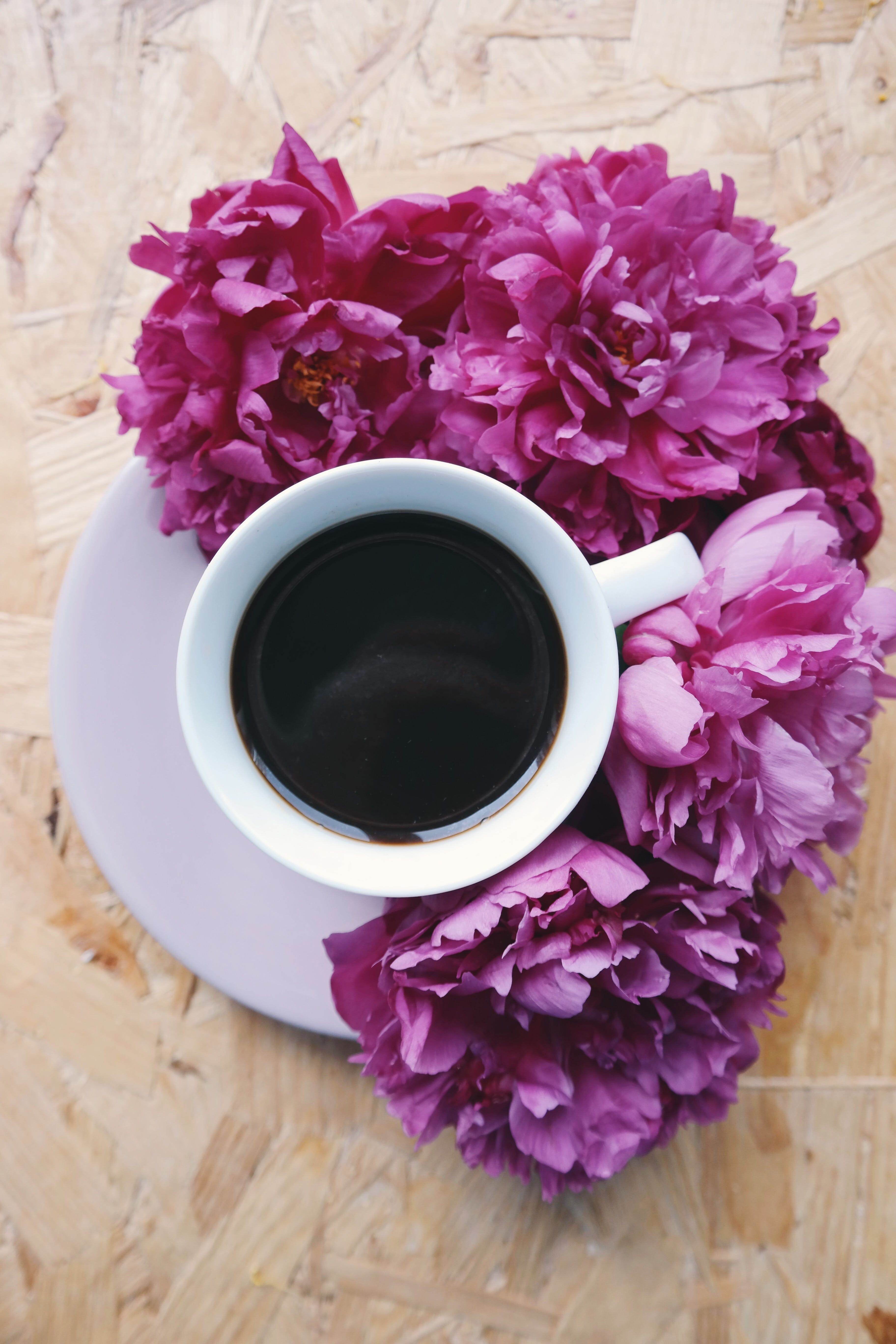 Cup of Coffee Beside Flowers