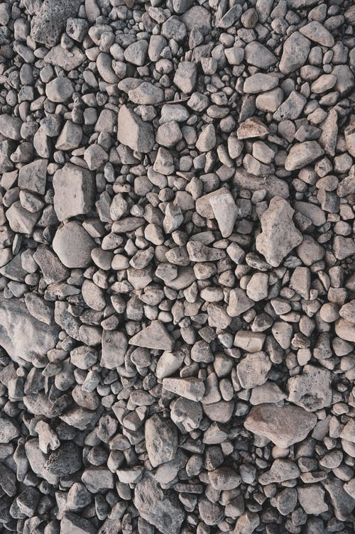 Abstract background of gray pebbles on ground