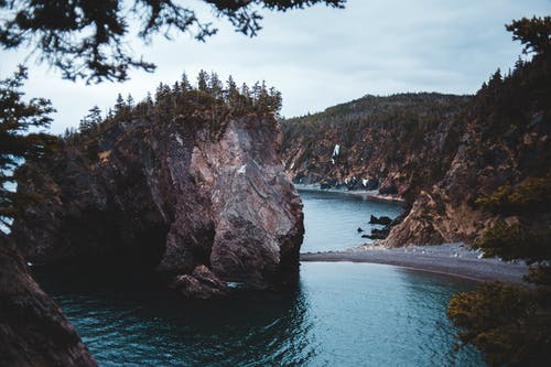 Rocky bay with trees on huge cliffs