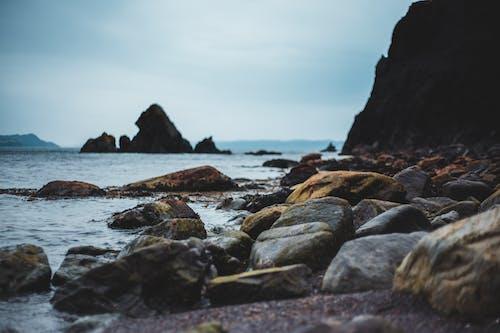 Big stones on seashore in overcast day