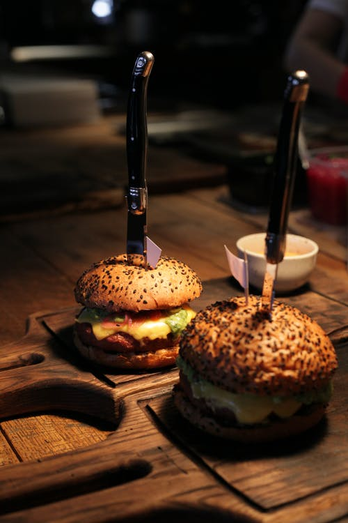 Burger With Patty and Lettuce on Brown Wooden Table
