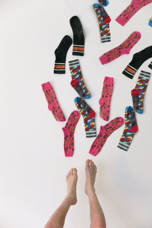 Modern bright socks and bare feet