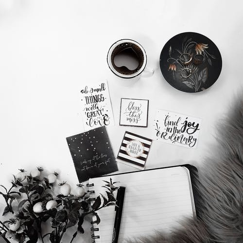 Opened notebook with cards and coffee