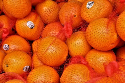 Fresh bright mandarins with stickers in bag