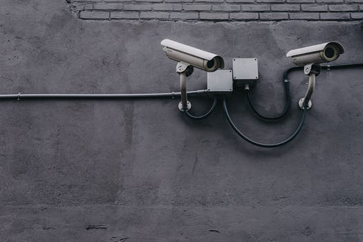 Two Gray Bullet Security Cameras