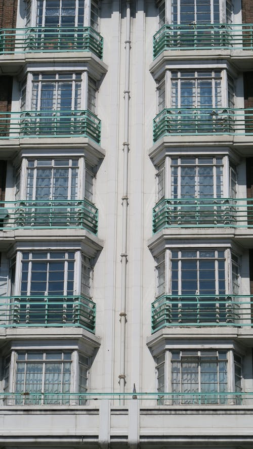 Free stock photo of architectural building, balconies, green, windows