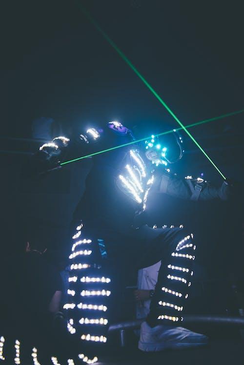 Man in Black Jacket Holding Green Light