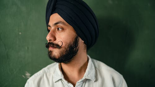 Young man with mustache and beard in turban