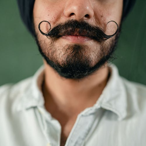 Crop ethnic man with glorious mustache