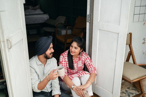 Happy couple talking on veranda in morning