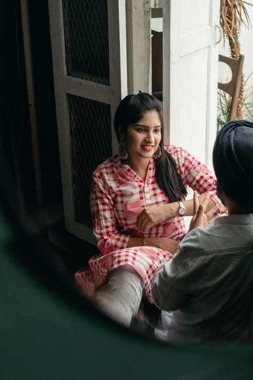 Couple enjoying free time at home and talking