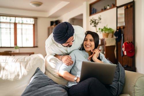 Ethnic couple having fun at home