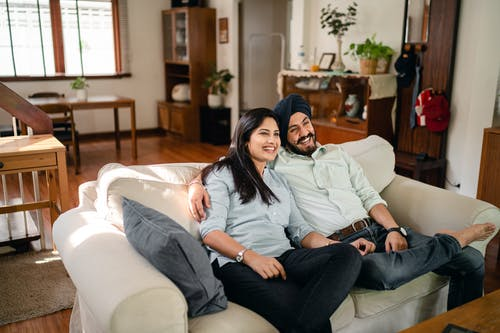 Happy ethnic couple enjoying time together at home
