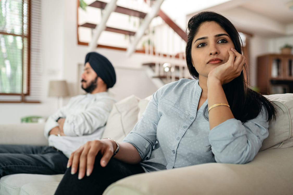 https://www.pexels.com/photo/sad-young-indian-woman-avoiding-talking-to-husband-while-sitting-on-sofa-4308049/