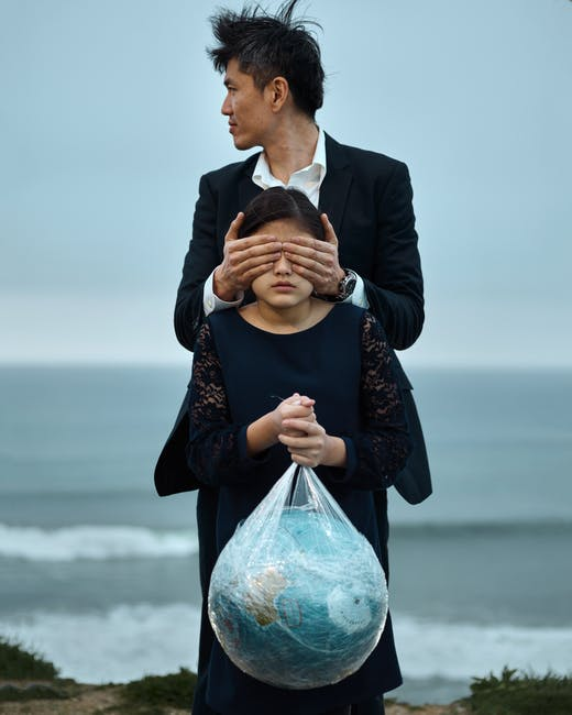 Man and girl with globe in plastic bag