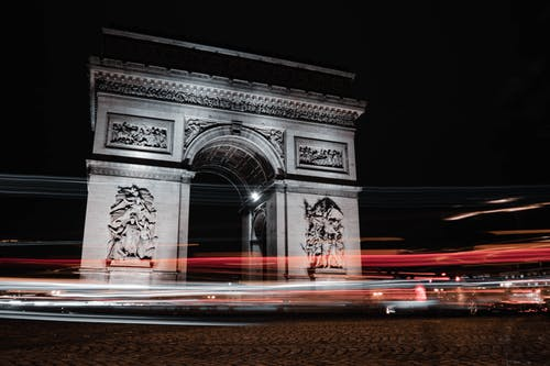 Brown Concrete Arch during Night Time