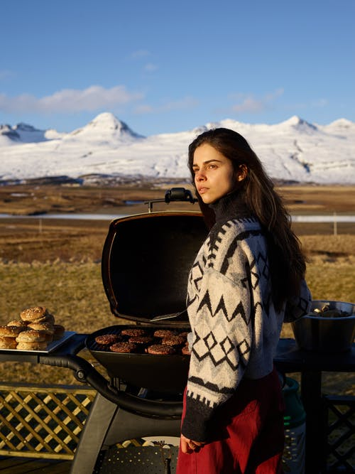 Young woman with grill in countryside