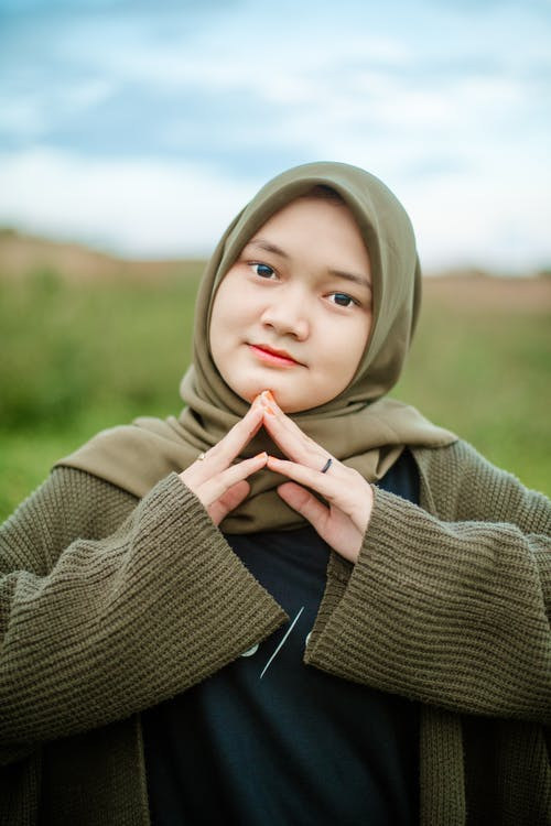 Young ethnic woman in traditional headscarf