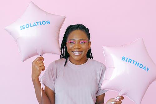 Smiling Woman Holding White Throw Pillow