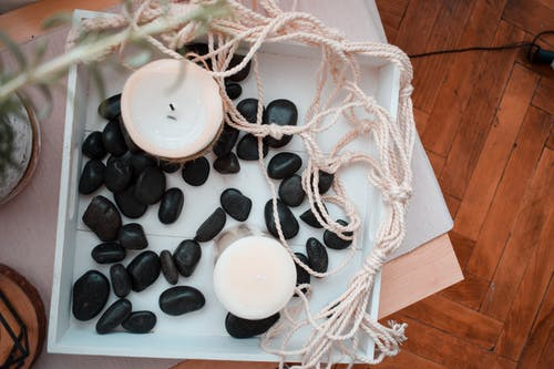 Home decoration with candles and black stones