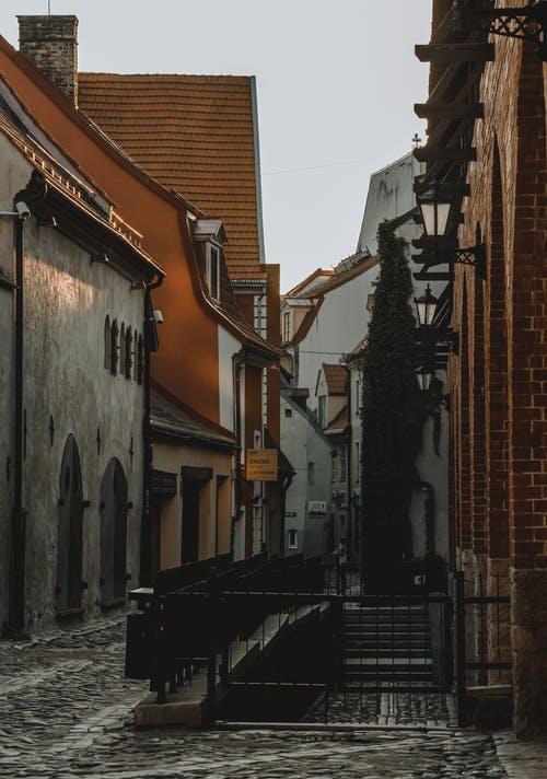 Old house facades and cobblestone pathway in town