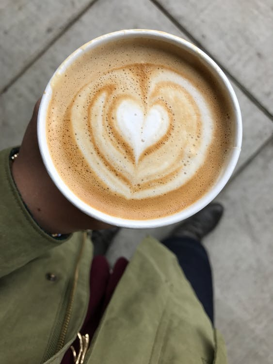 Person Holding Latte Cup