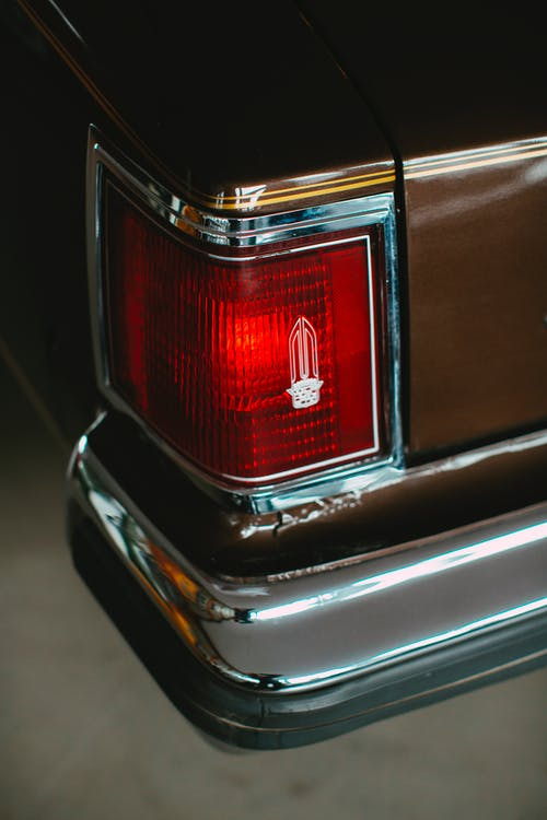 Red and Silver Car Tail Light