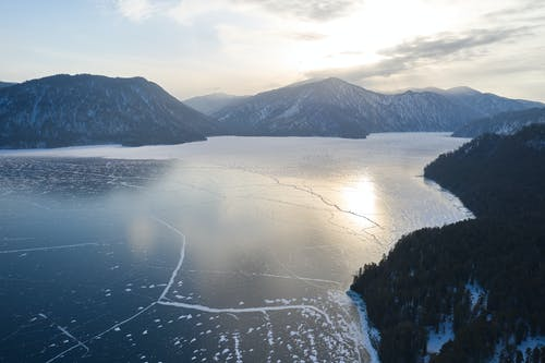 Snowy mountains and frozen lake in winter