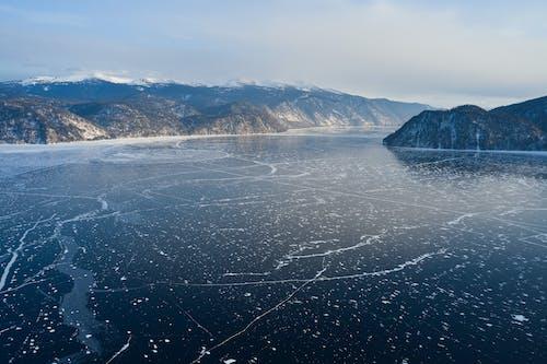 Mountainous terrain and frozen lake in winter