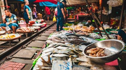 Fotos de stock gratuitas de acción, bazar, Cabina, calle