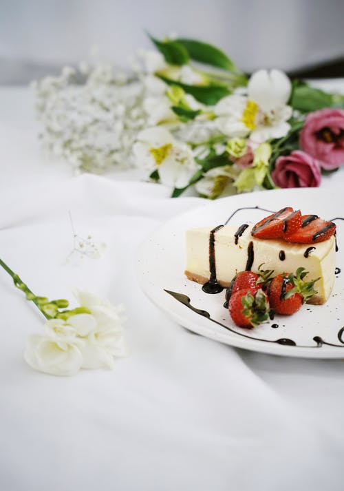 Sliced Strawberry Cake on White Ceramic Plate