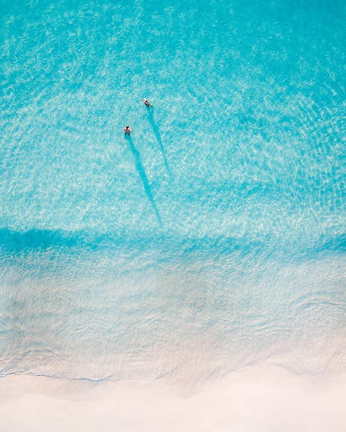 Person Surfing on Blue Sea