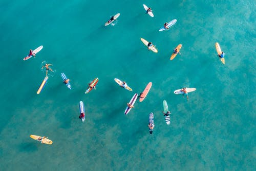 Aerial View of People Riding on Boat on Sea