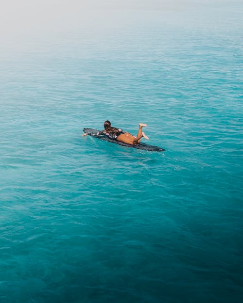 2 Person in the Middle of Ocean