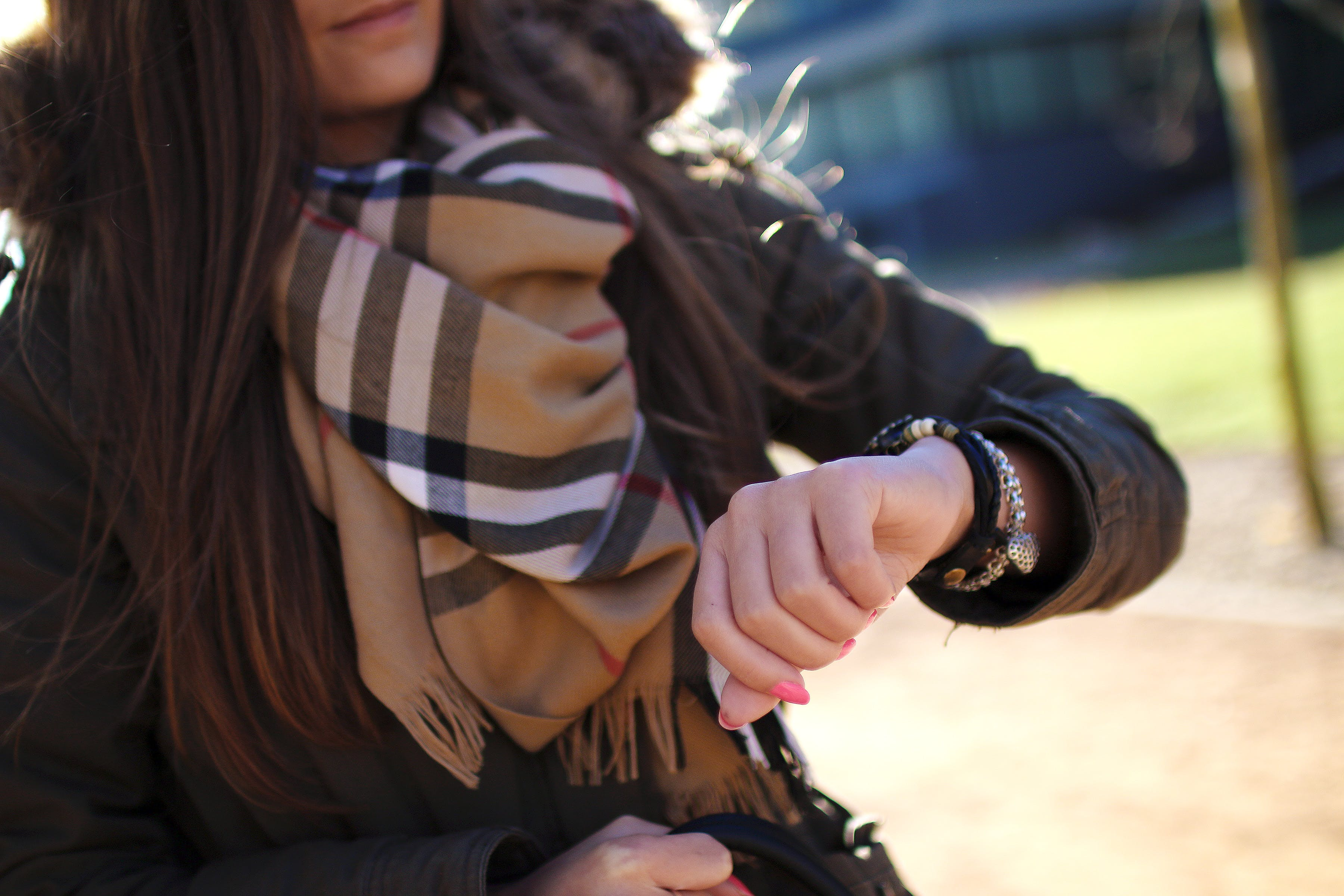 Woman Checking Time With Her Wristwatch