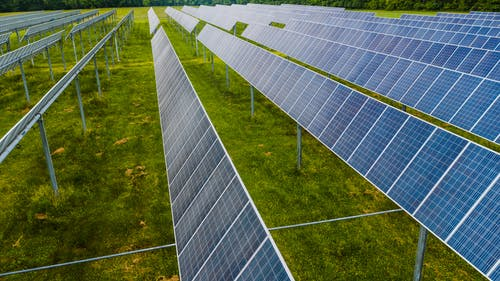 Solar modules on green field in photovoltaic station