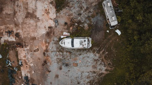 Abandoned yacht and truck junked in countryside