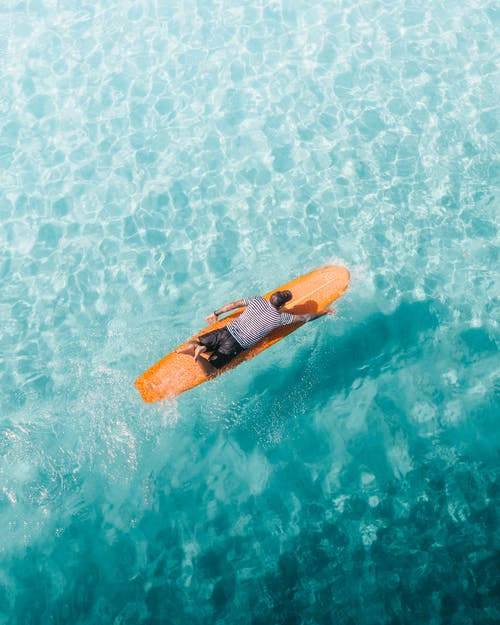 Orange and Yellow Surfboard on Body of Water