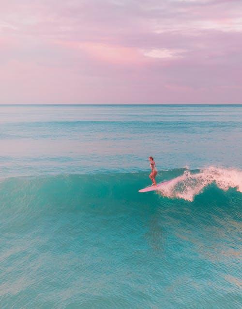 Woman in Blue Water