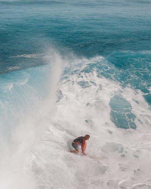 Woman in Black Bikini on Water Waves