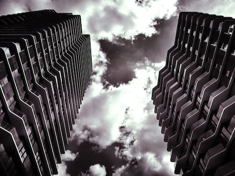 Free stock photo of black-and-white, city, clouds, buildings