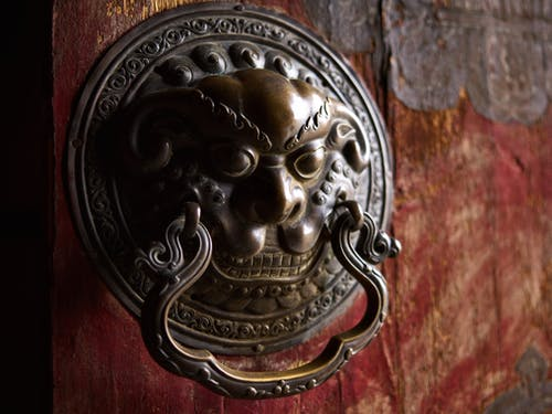 Ancient door handle on wooden door