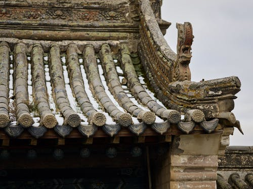 Roof of ancient oriental temple with carved details