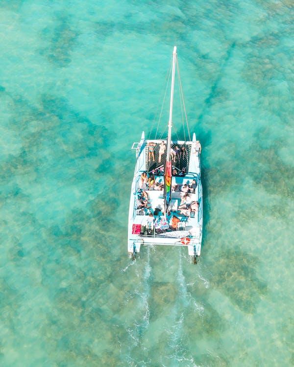 Modern boat floating on blue sea