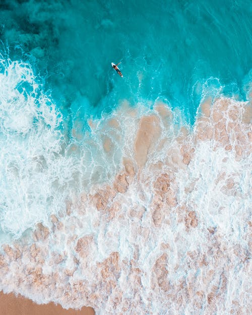 Aerial View of Person Surfing on Sea